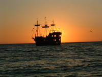 Sunset behind the Jolly Roger.