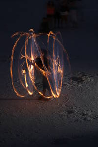 artits playing with fire on clearwater beach